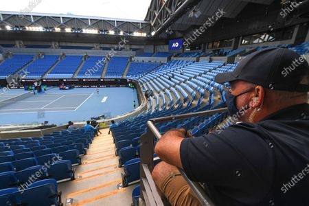 A match official wears a protective face mask in an empty Margaret Court Arena during the women's singles third round match between Ashleigh Barty of Australia and Ekaterina Alexandrova of Russia at the Australian Open Grand Slam tennis tournament at Melbourne Park in Melbourne, Australia, 13 February 2021.