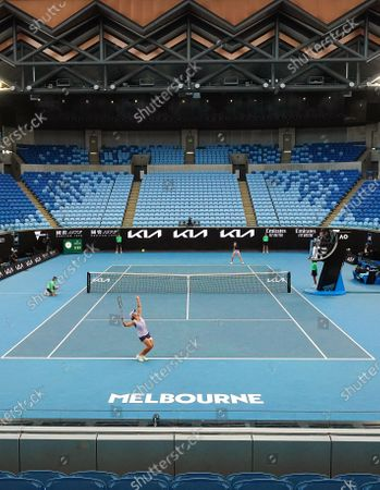 Stock Image of Ashleigh Barty (front) of Australia in action during her women's singles third round match against Ekaterina Alexandrova (back) of Russia at the Australian Open Grand Slam tennis tournament in an empty Margaret Court Arena at Melbourne Park in Melbourne, Australia, 13 February 2021.