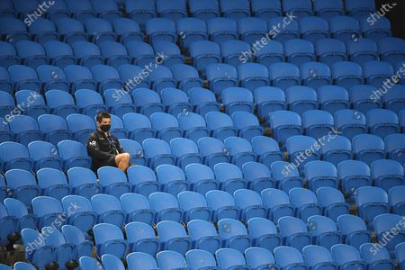 A lone spectator in an empty Margaret Court Arena during the women's singles third round match between Ashleigh Barty of Australia and Ekaterina Alexandrova of Russia at the Australian Open Grand Slam tennis tournament at Melbourne Park in Melbourne, Australia, 13 February 2021.