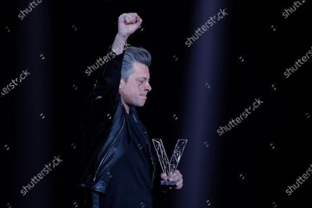"""French singer Benjamin Biolay reacts after receiving the Best Album award for """"Grand Prix"""" during the 36th Victoires de la Musique, the annual French music awards ceremony, at the Seine Musicale concert hall in Boulogne-Billancourt, on the outskirts of Paris"""