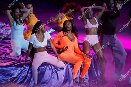 French singer Aya Coco Danioko aka Aya Nakamura, center, performs during the 36th Victoires de la Musique, the annual French music awards ceremony, at the Seine Musicale concert hall in Boulogne-Billancourt, on the outskirts of Paris