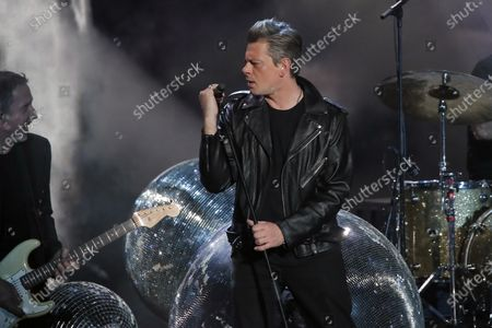 Stock Image of French singer Benjamin Biolay performs on stage during the 36th Victoires de la Musique, the annual French music awards ceremony, at the Seine Musicale concert hall in Boulogne-Billancourt, on the outskirts of Paris