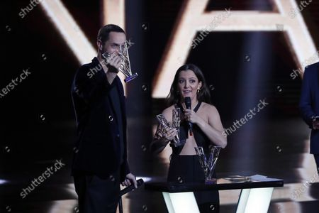 "French singer Fabien Marsaud aka Grand Corps Malade, left, and French singer Camille Lellouche, right, react after receiving the Best Music award for ""Mais je t'aime"" during the 36th Victoires de la Musique, the annual French music awards ceremony, at the Seine Musicale concert hall in Boulogne-Billancourt, on the outskirts of Paris"