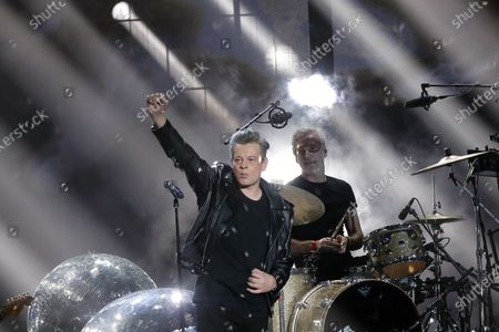 Stock Photo of French singer Benjamin Biolay performs on stage during the 36th Victoires de la Musique, the annual French music awards ceremony, at the Seine Musicale concert hall in Boulogne-Billancourt, on the outskirts of Paris