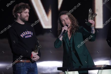 Stock Image of Brice VDH, left, and Julien Dore, right, receive the 'best audiovisual creation of the year' award during the 36th Victoires de la Musique, the annual French music awards ceremony, at the Seine Musicale concert hall in Boulogne-Billancourt, on the outskirts of Paris