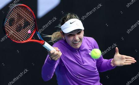 Croatia's Donna Vekic hits a forehand to Estonia's Kaia Kanepi during their match at the Australian Open tennis championships in Melbourne, Australia