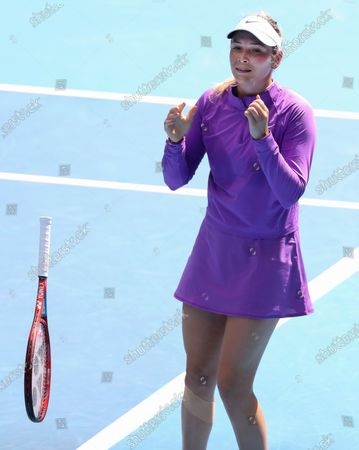 Croatia's Donna Vekic drops her racket as she celebrates her win over Estonia's Kaia Kanepi in their match at the Australian Open tennis championships in Melbourne, Australia