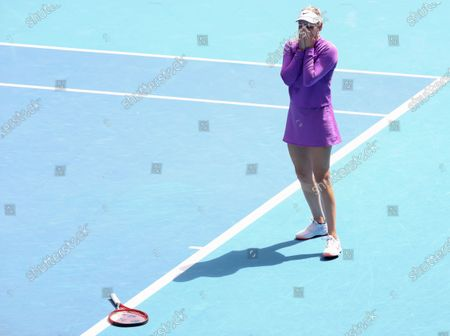 Stock Photo of Croatia's Donna Vekic drops her racket as she celebrates her win over Estonia's Kaia Kanepi in their match at the Australian Open tennis championships in Melbourne, Australia