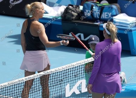 Croatia's Donna Vekic, right, and Estonia's Kaia Kanepi meet at the net after Vekic won their match at the Australian Open tennis championships in Melbourne, Australia