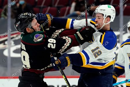 Stock Picture of Arizona Coyotes center Barrett Hayton (29) and St. Louis Blues left wing Zach Michael Sanford (12) battle in the first period during an NHL hockey game, in Glendale, Ariz
