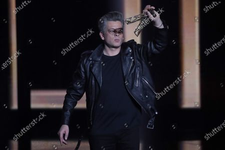 French singer Benjamin Biolay reacts after receiving the best male artist award during the 36th Victoires de la Musique, the annual French music awards ceremony, at the Seine Musicale concert hall in Boulogne-Billancourt, on the outskirts of Paris