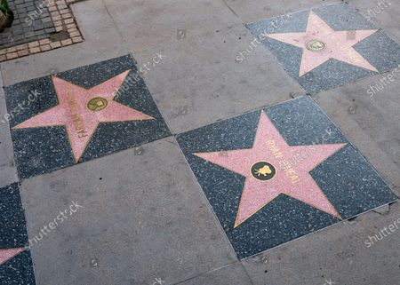 Stock Photo of General views of 'Love Story' actor Ryan O'Neal's new star on the Hollywood Walk of Fame. The star for Ryan O'Neal's off-screen love, Farrah Fawcett, faces and touches Ryan's star. A virtual unveiling ceremony for the new star took place earlier in the day