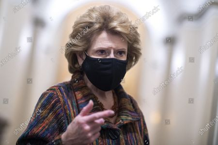 Sen. Debbie Stabenow, D-Mich., talks with reporters in the Capitol during a break in the impeachment trial of former President Donald Trump in Washington, DC, on Friday, February 12, 2021.   Pool photo by Tom Williams/UPI