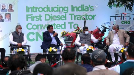 V.K. Singh (Minister of State for Road Transport and Highways), Nitin Gadkari (Union Minister for Road Transport and Highways), Dharmendra Pradhan (Union Minister for Petroleum and Natural Gas) and Parshottam Rupala (Minister of State for Agriculture and Farmers Welfare) are seen during the launch of India's first-ever diesel tractor, converted to Compressed Natural Gas(CNG) variant, in New Delhi, India on February 12, 2021.  (Photo by Mayank Makhija/NurPhoto)