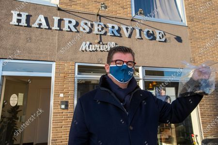 Stock Picture of Oostende Mayor Bart Tommelein pictured during a visit to the hairdresser, Saturday 13 February 2021, in Oudenburg. The consultative committee who evaluates the measures taken to control the average number of additional Covid-19 infections in Belgium decided that hairdressers will be allowed to reopen from Today.