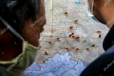 Exile Tibetans pin miniature Tibetan flags on their hometowns on a map of Tibet at a street event to mark the day when the 13th Dalai Lama declared Tibet an independent state in 1913, in Dharmsala, India, . Tibetans mark this day as Tibetan Independence Day