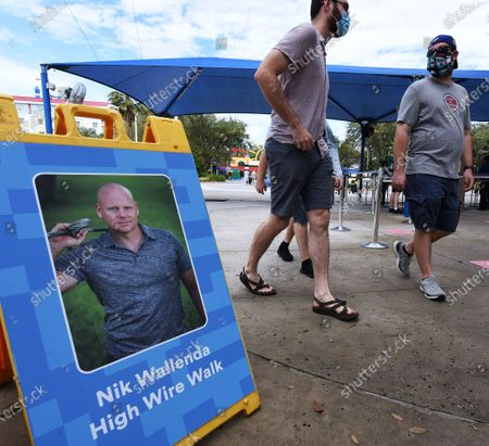 A sign promoting a high wire walk by aerialist Nik Wallenda is seen at the entrance to the LEGOLAND Florida resort before the daredevil walked a high wire for 600 feet between two buildings at the attraction on February 12, 2021 in Winter Haven, Florida. Wallenda performed the 60-foot high stunt with a balancing pole decorated with plastic LEGO bricks as part of the theme parks 10-year anniversary celebration.