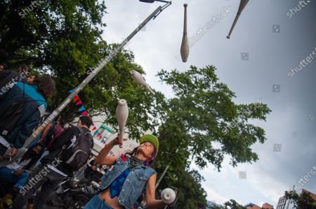 Stock Image of Demonstrators practice juggling as students from the Universidad Pedagogica in Bogota, demonstrate for the adquisition of a free tuition to its students after the novel Coronavirus pandemic caused an economic recession, in Bogota, Colombia on February 12, 2020.