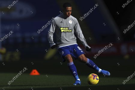 Leicester's Youri Tielemans warms up ahead of the English Premier League soccer match between Leicester City and Liverpool at the King Power Stadium in Leicester, England