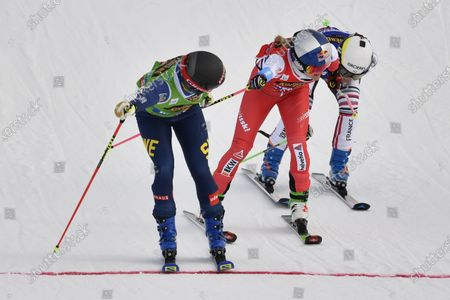 (L-R) Sweden's Sandra Naeslund wins ahead of Switzerland's Fanny Smith and France's Alizee Baron the women's final race at the FIS Ski Cross World Championships 2021 in Idre, Sweden, 13 February 2021.