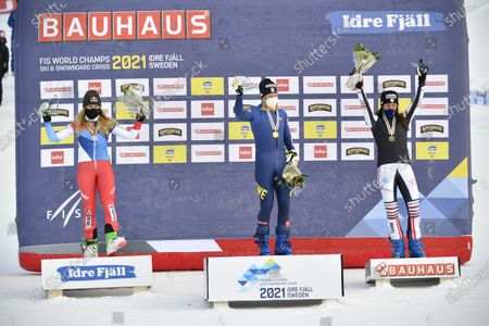 Winner Sandra Naeslund (C) of Sweden, second placed Fanny Smith (L) of Switzerland and third placed Alizee Baron (R) of France pose during the award ceremony for the women's race at the FIS Ski Cross World Championships 2021 in Idre, Sweden, 13 February 2021.