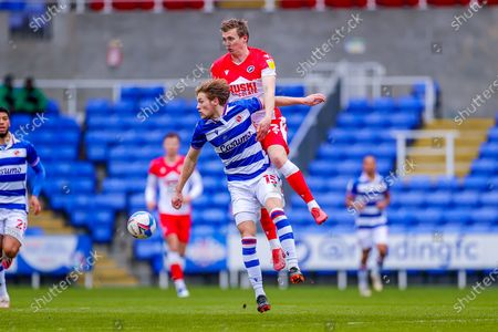 Jon Dadi Bodvarsson (22) of Millwall and Alex Pearce (15) of Millwall clash in the air during the EFL Sky Bet Championship match between Reading and Millwall at the Madejski Stadium, Reading