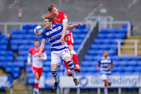 Jon Dadi Bodvarsson (22) of Millwall and Lewis Gibson (15) of Reading clash in the air during the EFL Sky Bet Championship match between Reading and Millwall at the Madejski Stadium, Reading
