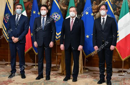 From L-R former Undersecretary of State at the Presidency of the Council of Ministers, Riccardo Fraccaro, outgoing prime minister Giuseppe Conte,  Italy's new Prime Minister Mario Draghi, and new Undersecretary of State at the Presidency of the Council of Ministers, Roberto Garofoli, during the handover ceremony at Chigi Palace in Rome, Italy, 13 February 2021. Former European Central Bank (ECB) chief Mario Draghi has been sworn in as Italy's prime minister after he put together a government securing broad support across political parties following the previous coalition's collapse.