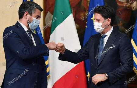 Stock Photo of Former Undersecretary of State at the Presidency of the Council of Ministers, Riccardo Fraccaro (L), and outgoing prime minister Giuseppe Conte during the handover ceremony at Chigi Palace in Rome, Italy, 13 February 2021. Former European Central Bank (ECB) chief Mario Draghi has been sworn in as Italy's prime minister after he put together a government securing broad support across political parties following the previous coalition's collapse.