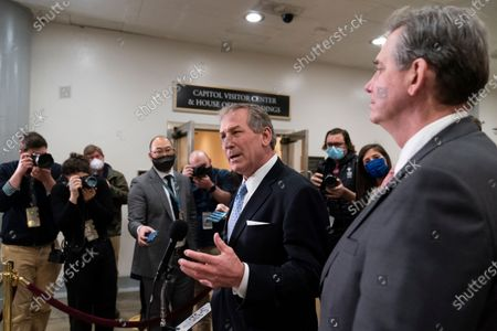 Michael van der Veen, left and Bruce Castor, attorneys from former President Donald Trump, speak with reporters on Capitol Hill after the Senate acquitted Trump in his second impeachment trial in the Senate at the U.S. Capitol in Washington, . Trump was accused of inciting the Jan. 6 attack on the U.S. Capitol, and the acquittal gives him a historic second victory in the court of impeachment. Jason Miller, former senior advisor to 2020 Trump campaign, stands at right