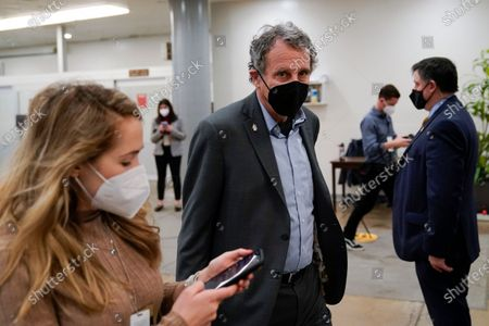 Sen. Sherrod Brown, D-Ohio, walks on Capitol Hill in Washington, before the fifth day of the second impeachment trial of former President Donald Trump