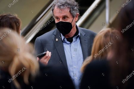 Sen. Sherrod Brown, D-Ohio, talks to reporters on Capitol Hill in Washington, before the fifth day of the second impeachment trial of former President Donald Trump
