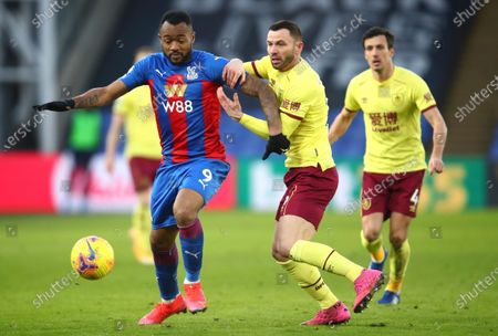 Crystal Palace's Jordan Ayew, left, and Burnley's Phil Bardsley challenge for the ball during the English Premier League soccer match between Crystal Palace and Burnley at Selhurst Park stadium in London, England