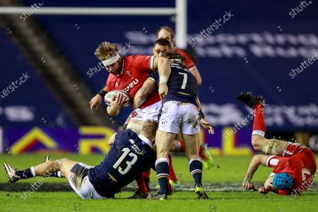 Scotland vs Wales. Wales' Aaron Wainwright is tackled by Chris Harris and Hamish Watson of Scotland