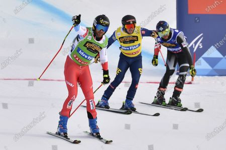 Stock Image of IDRE 20210213 Alex Fiva (green) SUI winner in the final Sweden's Erik Mobaerg (yellow) third place and Oliver Davis (blue) GBR fourth place FIS Ski Cross World Championship 2021 at Idre