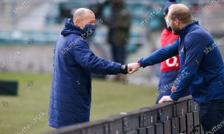 Stock Image of England Head Coach Eddie Jones fist bumps with James Haskell pre-match
