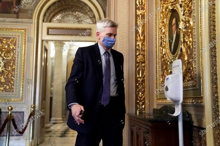 Sen. Bill Cassidy, R-La., walks on Capitol Hill after the Senate acquitted former President Donald Trump in his second impeachment trial in the Senate at the U.S. Capitol in Washington, . Trump was accused of inciting the Jan. 6 attack on the U.S. Capitol, and the acquittal gives him a historic second victory in the court of impeachment
