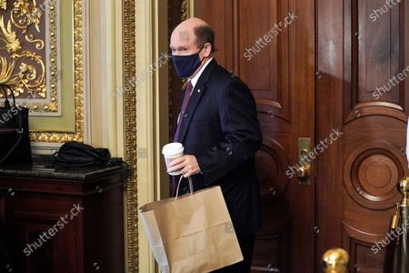 Sen. Chris Coons (D-Del.) accidentally tries to have lunch in the room where attorneys for former President Donald Trump are meeting in as the Senate takes a short recess during the fifth day of the impeachment trial of former President Trump in Washington, DC, USA, 13 February 2021.  The Senate passed a motion to subpoena witnesses in the Senate impeachment trial of former US president Trump, on the charge of incitement of insurrection for his role in 06 January violent attack on the US Capitol.