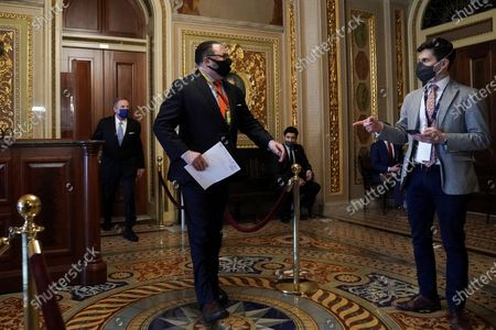 Jason Miller, advisor to former President Donald Trump, is seen carrying a witness list in the Senate Reception Room on the fifth day of the impeachment trial of former President Trump in Washington, DC, USA, 13 February 2021.  The Senate passed a motion to subpoena witnesses in the Senate impeachment trial of former US president Trump, on the charge of incitement of insurrection for his role in 06 January violent attack on the US Capitol.