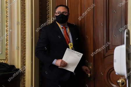 Jason Miller, advisor to former US president Trump, is seen carrying a witness list on the fifth day of the impeachment trial of former President Trump in Washington, DC, USA, 13 February 2021.  The Senate passed a motion to subpoena witnesses in the Senate impeachment trial of former US president Trump, on the charge of incitement of insurrection for his role in 06 January violent attack on the US Capitol.