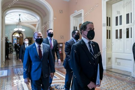 Democratic House impeachment managers, from left, Rep. David Cicilline, D-R.I., Rep. Eric Swalwell, D-Calif., Rep. Jamie Raskin, D-Md., and Rep. Joe Neguse, D-Colo., depart the Senate chamber after the impeachment trial of former President Donald Trump ended, at the Capitol in Washington, . Trump was found not guilty of the charge of inciting the January 6 attack on the Congress by a mob of his supporters