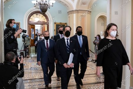 Democratic House impeachment managers, from left, Rep. David Cicilline, D-R.I., Rep. Eric Swalwell, D-Calif., Rep. Jamie Raskin, D-Md., and Rep. Joe Neguse, D-Colo., depart the Senate chamber, escorted at right by Acting Sergeant at Arms Jennifer Hemingway, after the impeachment trial of former President Donald Trump ended, at the Capitol in Washington, . Trump was found not guilty of the charge of inciting the January 6 attack on the Congress by a mob of his supporters