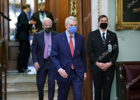 Sen. Rob Portman, R-Ohio, leaves the chamber after the Senate voted to consider hearing from witnesses in the impeachment trial of former President Donald Trump, at the Capitol in Washington