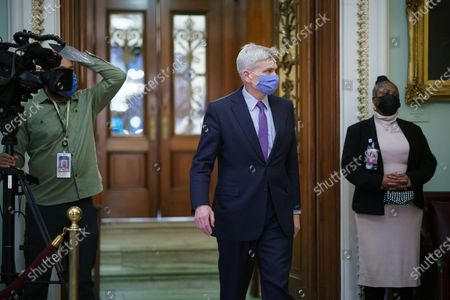 Sen. Bill Cassidy, R-La., leaves the chamber as the Senate voted to consider hearing from witnesses in the impeachment trial of former President Donald Trump, at the Capitol in Washington