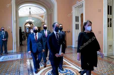 Democratic House impeachment managers, from left, Rep. David Cicilline, D-R.I., Rep. Eric Swalwell, D-Calif., Rep. Jamie Raskin, D-Md., and Rep. Joe Neguse, D-Colo., depart the Senate chamber, escorted at right by Acting Sergeant at Arms Jennifer Hemingway, right, after the impeachment trial of former President Donald Trump ended, at the Capitol in Washington, . Trump was found not guilty of the charge of inciting the January 6 attack on the Congress by a mob of his supporters