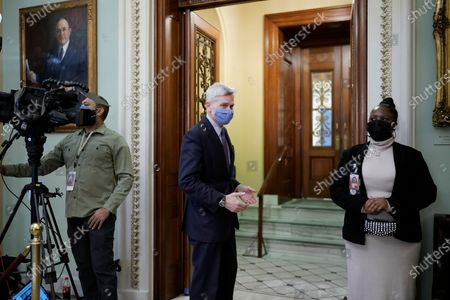 Sen. Bill Cassidy, R-La., walks into the Senate Chamber at the Capitol as the Senate proceeds in a rare weekend session for final arguments in the second impeachment trial of former President Donald Trump, at the Capitol in Washington