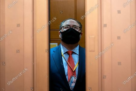 Jason Miller, former senior advisor to 2020 Trump campaign, wears a protective mask in an elevator in the US Capitol on the fifth day of the impeachment trial of former US president Trump, in Washington, DC, USA, 13 February 2021. An impeachment trial against former US president Trump is held on the charge of incitement of insurrection for his role in 06 January violent attack on the US Capitol.