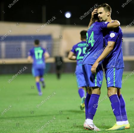Al-Fateh's player Mitchell Te Vrede (R) celebrates after scoring a goal during the Saudi Professional League soccer match between Al-Fateh and Al-Ain at Prince Abdullah bin Jalawi Stadium, in Al-Hasa, Saudi Arabia, 13 February 2021.