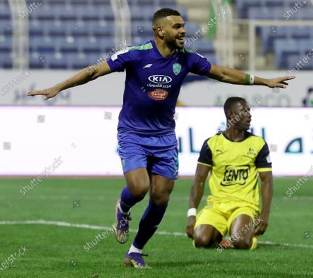 Al-Fateh's player El Arbi Hillel Soudani (front) celebrates after his teammate Mitchell Te Vrede (not pictured) scores a goal during the Saudi Professional League soccer match between Al-Fateh and Al-Ain at Prince Abdullah bin Jalawi Stadium, in Al-Hasa, Saudi Arabia, 13 February 2021.