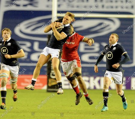Chris Harris - Scotland centre takes a high ball as he is challenged by Wales number 8 Taulupe Faletau.